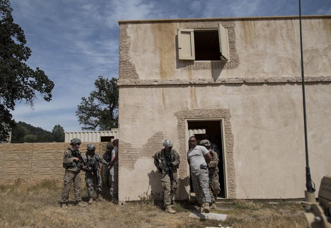 Two teams of U.S. Army Reserve military police Soldiers from the 56th Military Police Company (Combat Support), of Mesa, Arizona, find and detain two high-value targets during a cordon and search training lane at Fort Hunter-Liggett, California, May 4. Approximately 80 units from across the U.S. Army Reserve, Army National Guard and active Army are participating in the 84th Training Command's second Warrior Exercise this year, WAREX 91-16-02, hosted by the 91st Training Division at Fort Hunter-Liggett, California. (U.S. Army photo by Master Sgt. Michel Sauret)