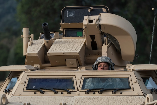 Spc. Adrianna Harris, a U.S. Army Reserve military police Soldier from Los Angeles, with the 56th Military Police Company (Combat Support), of Mesa, Arizona, drives an M1117 Armored Security Vehicle to a staging area in preparation for a cordon and search training lane at Fort Hunter-Liggett, California, May 4. Approximately 80 units from across the U.S. Army Reserve, Army National Guard and active Army are participating in the 84th Training Command's second Warrior Exercise this year, WAREX 91-16-02, hosted by the 91st Training Division at Fort Hunter-Liggett, California. (U.S. Army photo by Master Sgt. Michel Sauret)