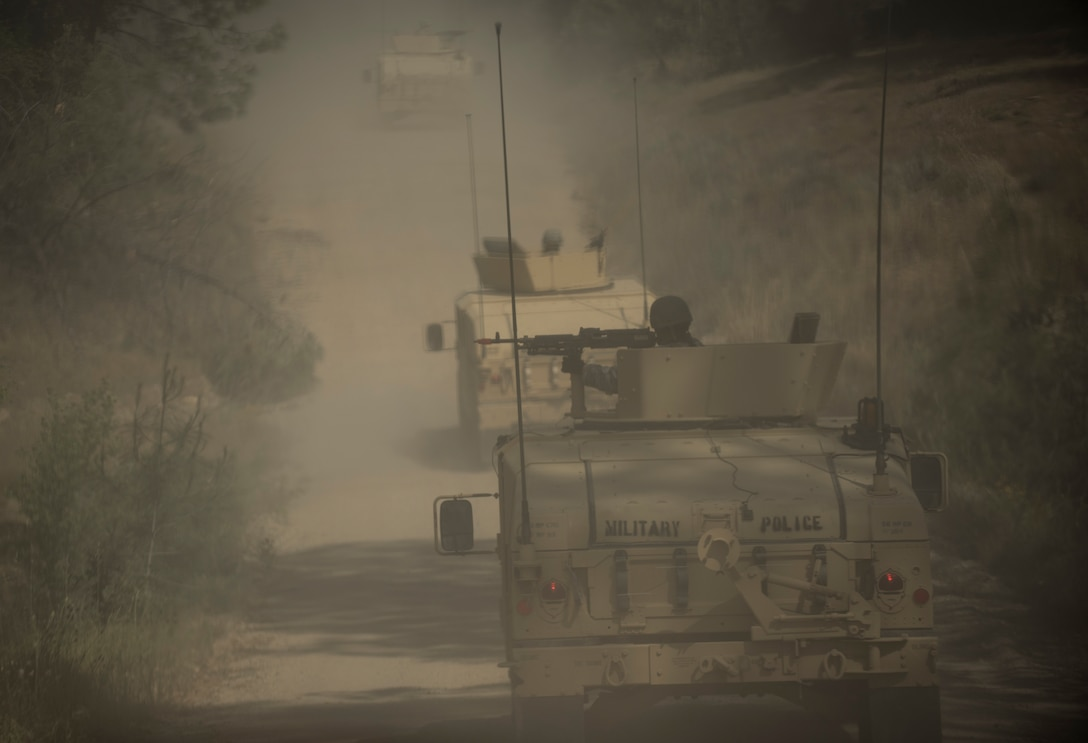 A convoy of gunner vehicles kicks up dust during a cordon and search training lane at Fort Hunter-Liggett, California, conducted by U.S. Army Reserve military police Soldiers from the 56th Military Police Company (Combat Support), of Mesa, Arizona, May 4. Approximately 80 units from across the U.S. Army Reserve, Army National Guard and active Army are participating in the 84th Training Command's second Warrior Exercise this year, WAREX 91-16-02, hosted by the 91st Training Division at Fort Hunter-Liggett, California. (U.S. Army photo by Master Sgt. Michel Sauret)