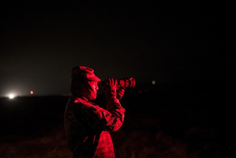 A U.S. Army Reserve military police Soldier from the 341st MP Company, of Mountain View, California, looks down range using a machine gun night scope during a mounted crew-served weapon qualification table at Fort Hunter-Liggett, California, May 4. The 341st MP Co. is one of the first units in the Army Reserve conducting a complete 6-table crew-serve weapon qualification, which includes firing the M2, M249 and M240B machine guns both during the day and night. (U.S. Army photo by Master Sgt. Michel Sauret)