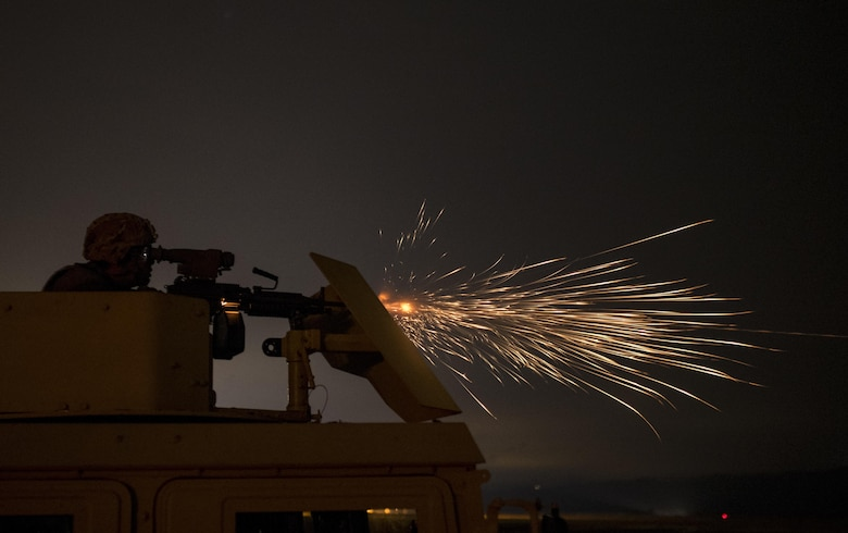 A U.S. Army Reserve military police Soldier from the 341st MP Company, of Mountain View, California, fires an M249 Squad Automatic Weapon mounted on a High Mobility Multi-Purpose Wheeled Vehicle turret during a night fire qualification table at Fort Hunter-Liggett, California, May 4. The 341st MP Co. is one of the first units in the Army Reserve conducting a complete 6-table crew-serve weapon qualification, which includes firing the M2, M249 and M240B machine guns both during the day and night. (U.S. Army photo by Master Sgt. Michel Sauret)