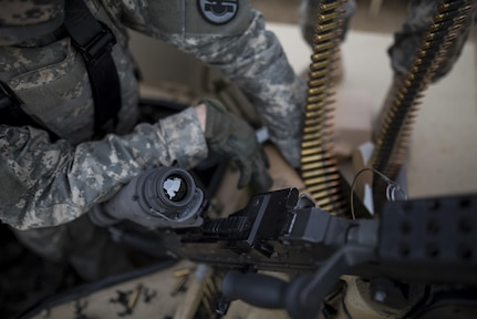 U.S. Army Reserve military police Soldiers from the 341st MP Company, of Mountain View, California, prepare an M249 Squad Automatic Weapon for a mounted crew-served weapon night fire qualification table at Fort Hunter-Liggett, California, May 4. The 341st MP Co. is one of the first units in the Army Reserve conducting a complete 6-table crew-serve weapon qualification, which includes firing the M2, M249 and M240B machine guns both during the day and night. (U.S. Army photo by Master Sgt. Michel Sauret)