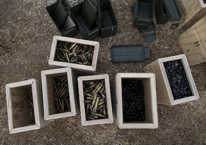 Expended brass shells and discarded clips are collected into various boxes for turn in throughout a mounted crew-served weapon qualification range at Fort Hunter-Liggett, California, conducted by U.S. Army Reserve military police Soldiers from the 341st MP Company, of Mountain View, California, May 4. The 341st MP Co. is one of the first units in the Army Reserve conducting a complete 6-table crew-serve weapon qualification, which includes firing the M2, M249 and M240B machine guns both during the day and night. (U.S. Army photo by Master Sgt. Michel Sauret)