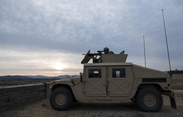 A U.S. Army Reserve military police Soldier from the 341st MP Company, of Mountain View, California, fires an M249 Squad Automatic Weapon mounted on a High Mobility Multi-Purpose Wheeled Vehicle turret during a qualification table at Fort Hunter-Liggett, California, May 4. The 341st MP Co. is one of the first units in the Army Reserve conducting a complete 6-table crew-serve weapon qualification, which includes firing the M2, M249 and M240B machine guns both during the day and night. (U.S. Army photo by Master Sgt. Michel Sauret)