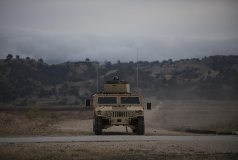 A U.S. Army Reserve military police crew from the 341st MP Company, of Mountain View, California, returns from a mounted crew-served weapon qualification table at Fort Hunter-Liggett, California, May 4. The 341st MP Co. is one of the first units in the Army Reserve conducting a complete 6-table crew-serve weapon qualification, which includes firing the M2, M249 and M240B machine guns both during the day and night. (U.S. Army photo by Master Sgt. Michel Sauret)