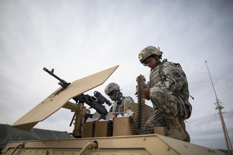 U.S. Army Reserve military police Soldiers from the 341st MP Company, of Mountain View, California, prepare an M240B machine gun for a mounted crew-served weapon night fire qualification table at Fort Hunter-Liggett, California, May 4. The 341st MP Co. is one of the first units in the Army Reserve conducting a complete 6-table crew-serve weapon qualification, which includes firing the M2, M249 and M240B machine guns both during the day and night. (U.S. Army photo by Master Sgt. Michel Sauret)