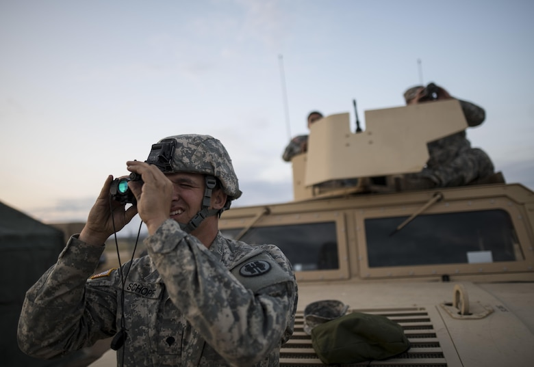 Spc. Bradley Schopf, a U.S. Army Reserve military police Soldier with the 341st MP Company, of Tracy, Califonia, tests out his night optics before a mounted crew-served weapon qualification night fire table at Fort Hunter-Liggett, California, May 3. The 341st MP Co. is one of the first units in the Army Reserve conducting a complete 6-table crew-serve weapon qualification, which includes firing the M2, M249 and M240B machine guns both during the day and night. (U.S. Army photo by Master Sgt. Michel Sauret)