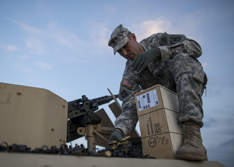 Spc. Trenton Beck, of Marysville, California, a U.S. Army Reserve military police Soldier from the 341st MP Company, of Mountain View, California, picks up .50-caliber shell casings off a vehicle roof after a M2 Bradley firing table at Fort Hunter-Liggett, California, May 3. The 341st MP Co. is one of the first units in the Army Reserve conducting a complete 6-table crew-serve weapon qualification, which includes firing the M2, M249 and M240B machine guns both during the day and night. (U.S. Army photo by Master Sgt. Michel Sauret)
