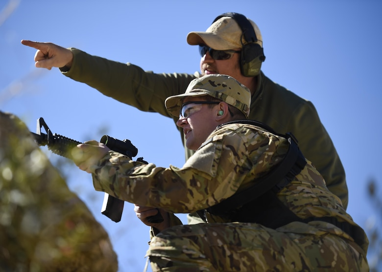 A field skills instructor with the 371st Special Operations Combat Training Squadron directs Senior Airman Connor Hollingshead, a remotely piloted aircraft sensor operator with the 12th Special Operations Squadron, to engage steel targets during a 'stress test' at a firing range near Baker, Fla., Feb. 25, 2016. During the final evolution of training, students ran a 'stress test.' The exercise was intended to build students' confidence translating the drills they practiced during their three days of range time, to actuals skills they may need downrange. (U.S. Air Force photo by Airman 1st Class Kai White)