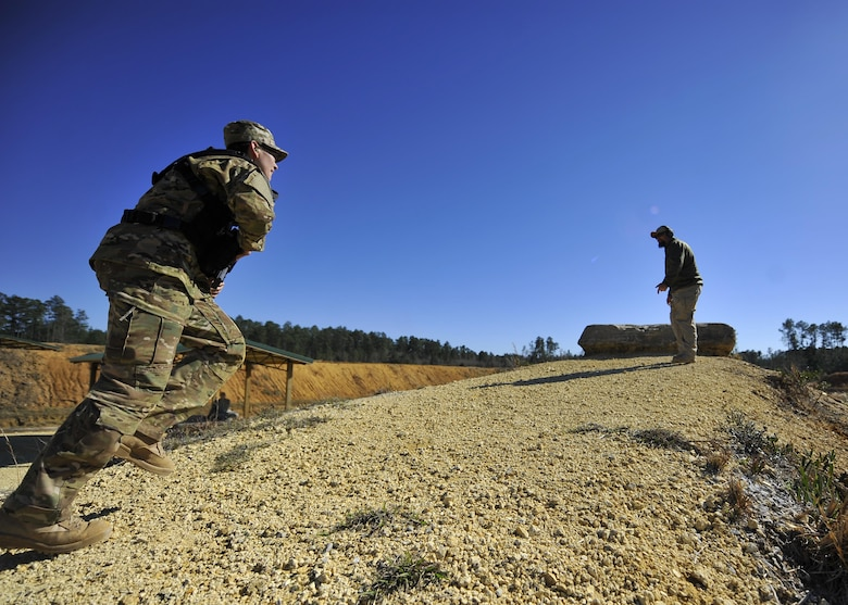 Second Lt. Blaine Driscoll, a combat systems operator with the 19th Special Operations Squadron, runs to the final station of his 'stress test' at a firing range near Baker, Fla., Feb. 25, 2016. During the final evolution of training, students ran a 'stress test.' The exercise was intended to build students' confidence translating the drills they practiced during their three days of range time, to actuals skills they may need downrange. (U.S. Air Force photo by Airman 1st Class Kai White)