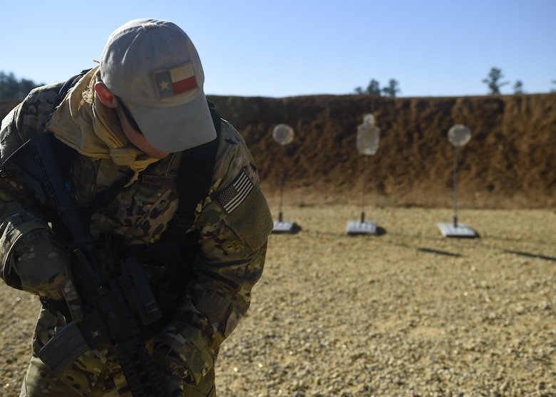 First Lt. Austin Zimmer, a U-28A pilot with the 318th Special Operations Squadron, practices the 'El Presidente' drill with his M4 carbine at a firing range near Baker, Fla., Feb. 24, 2016. The 'El Presidente' drill was developed to train shooters to identify and engage multiple targets quickly and accurately at short ranges. The irregular nature of Air Force Special Operations Command's mission sometimes require air crews to operate in austere conditions downrange, which prompted the creation of the Air Commando Field Skills Course. (U.S. Air Force photo by Airman 1st Class Kai White)