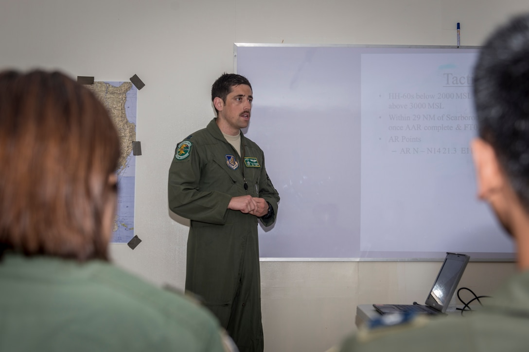 U.S. Air Force Capt. Tilt Culpepper, an A-10C Thunderbolt II pilot with the 25th Fighter Squadron, Osan Air Base, Republic of Korea, briefs U.S. Philippine Air Force (PAF) aircrew members on the mission of the A-10 as part of U.S. Pacific Command's Air Contingent at Clark Air Base, Philippines, April 28, 2016. The briefing afforded PAF aircrew members an opportunity to experience how U.S. Air Force aircrew members operate the airframe. The A-10C has a mission profile consistent with the air and maritime domain awareness operations U.S. Pacific Command's Air Contingent is conducting out of the air base, as it is capable of loitering close to the surface for extended periods to allow for excellent visibility over land and sea domains. This bilateral engagement strengthened the already close partnership between U.S. and Philippine armed forces. (U.S. Air Force photo by Staff Sgt. Benjamin W. Stratton)
