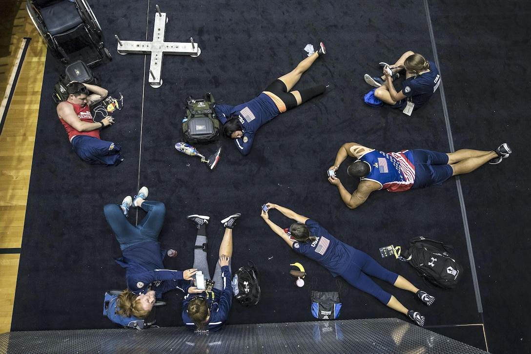 Team USA rowers take a break between sessions while training for the 2016 Invictus Games in Orlando, Fla., May 5, 2016. DoD photo by Roger Wollenberg