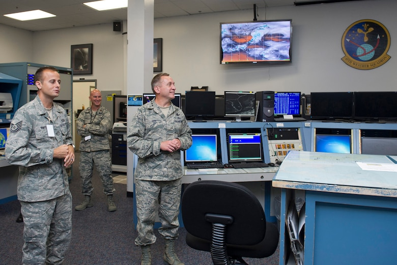 Tech. Sgt. Jordan Smith and Maj. Jeffrey Smith, both from the 45th Weather Squadron, tell Lt. Gen. David J. Buck, commander, 14th Air Force (Air Forces Strategic), Air Force Space Command; and commander, Joint Functional Component Command for Space, U.S. Strategic Command, about the 45th WS and how they support launch operations while he tours the Morrell Operations Center at Cape Canaveral Air Force Station, Florida, May 5, 2016. Buck and Chief Master Sgt. Craig Neri, 14th AF command chief and command senior enlisted leader for JFCC Space, visited Patrick Air Force Base and Cape Canaveral Air Force Station May 4 and 5 and gained insight into the contributions Airmen across the wing make to keep the 45th Space Wing the World's Premier Gateway to Space. (U.S. Air Force photo by Matthew Jurgens/Released)