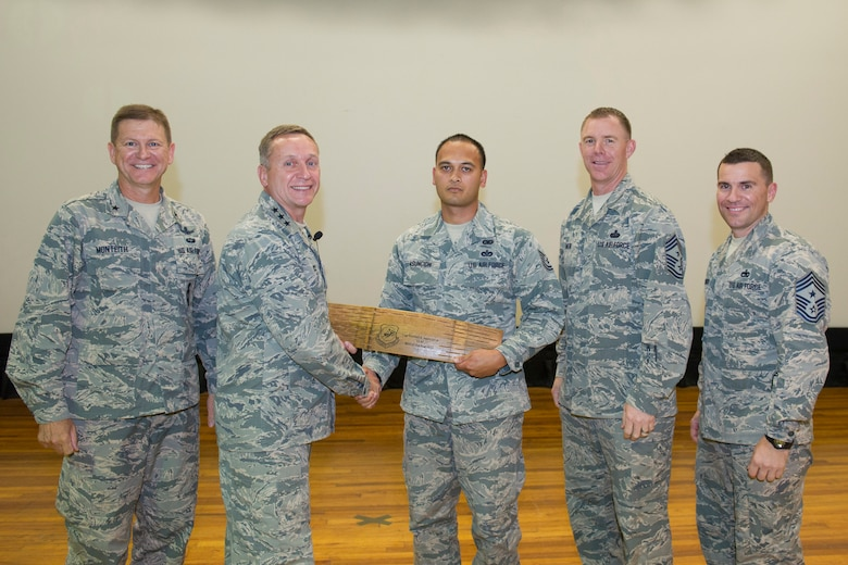 Tech. Sgt. Michael Asuncion, Jr., 45th Civil Engineer Squadron, is presented the 14th Air Force Non-commissioned officer of the Year Award for 2015 at an all call hosted by the 14th Air Force commander and command chief May 4, 2016, at Patrick Air Force Base, Florida. During the all call, Lt. Gen. David J. Buck, commander, 14th Air Force (Air Forces Strategic), Air Force Space Command; and commander, Joint Functional Component Command for Space, U.S. Strategic Command, and Chief Master Sgt. Craig Neri, 14th AF command chief and command senior enlisted leader for JFCC Space, touched on what it takes to be a good Airman and presented several awards. (U.S. Air Force photo by Matthew Jurgens/Released)