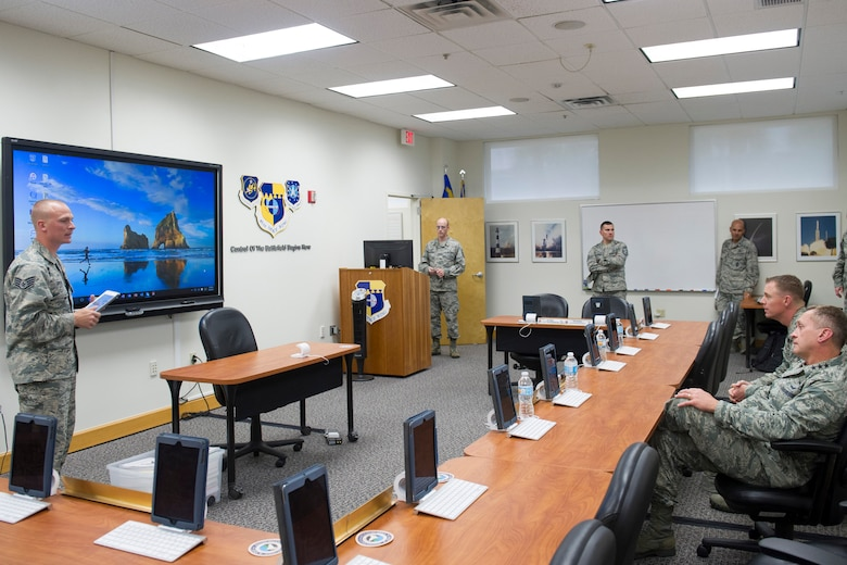 Airmen leadership school instructors describe how they've innovated using iPads in their course material to Lt. Gen. David J. Buck, commander, 14th Air Force (Air Forces Strategic), Air Force Space Command; and commander, Joint Functional Component Command for Space, U.S. Strategic Command, and Chief Master Sgt. Craig Neri, 14th AF command chief and command senior enlisted leader for JFCC Space, at the Patrick Air Force Base Professional Development Center May 4, 2016. Buck and Neri visited Patrick Air Force Base and Cape Canaveral Air Force Station May 4 and 5 and gained insight into the contributions Airmen across the wing make to keep the 45th Space Wing the World's Premier Gateway to Space. (U.S. Air Force photo by Matthew Jurgens/Released)