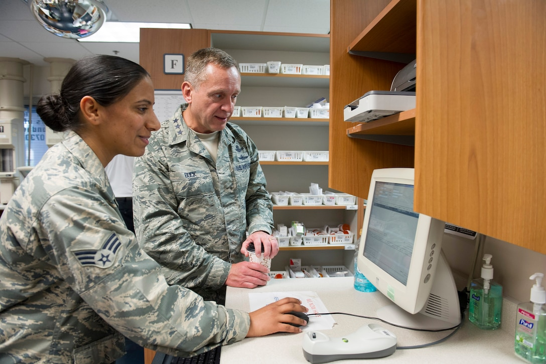 Senior Airman Kulwinder McDaniel, 45th Medical Group, shows Lt. Gen. David J. Buck, commander, 14th Air Force (Air Forces Strategic), Air Force Space Command; and commander, Joint Functional Component Command for Space, U.S. Strategic Command, the process used to manage and distribute prescriptions at the Satellite Pharmacy on Patrick Air Force Base, Florida, May 4, 2016. Buck and Chief Master Sgt. Craig Neri, 14th AF command chief and command senior enlisted leader for JFCC Space, visited Patrick Air Force Base and Cape Canaveral Air Force Station May 4 and 5 and gained insight into the contributions Airmen across the wing make to keep the 45th Space Wing the World's Premier Gateway to Space. (U.S. Air Force photo by Matthew Jurgens/Released)