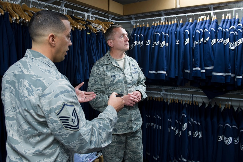 Master Sgt. Jason Charlemagne, Patrick Air Force Base Honor Guard superintendent, describes his efforts in designing a facility renovation and uniform recycling project to Lt. Gen. David J. Buck, commander, 14th Air Force (Air Forces Strategic), Air Force Space Command; and commander, Joint Functional Component Command for Space, U.S. Strategic Command, May 4, 2016, at Patrick AFB, Florida. Buck and Chief Master Sgt. Craig Neri, 14th AF command chief and command senior enlisted leader for JFCC Space, visited Patrick Air Force Base and Cape Canaveral Air Force Station May 4 and 5 and gained insight into the contributions Airmen across the wing make to keep the 45th Space Wing the World's Premier Gateway to Space. (U.S. Air Force photo by Matthew Jurgens/Released)