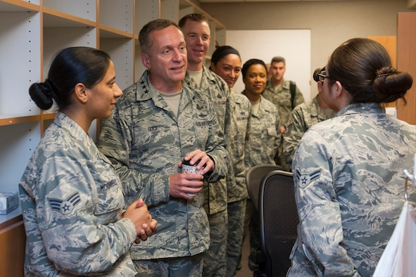 Lt. Gen. David J. Buck, commander, 14th Air Force (Air Forces Strategic), Air Force Space Command; and commander, Joint Functional Component Command for Space, U.S. Strategic Command, and Chief Master Sgt. Craig Neri, 14th AF command chief and command senior enlisted leader for JFCC Space, talk with Airmen working at the Satellite Pharmacy on Patrick Air Force Base, Florida, May 4, 2016. Buck and Neri visited Patrick Air Force Base and Cape Canaveral Air Force Station May 4 and 5 and gained insight into the contributions Airmen across the wing make to keep the 45th Space Wing the World's Premier Gateway to Space. (U.S. Air Force photo by Matthew Jurgens/Released)