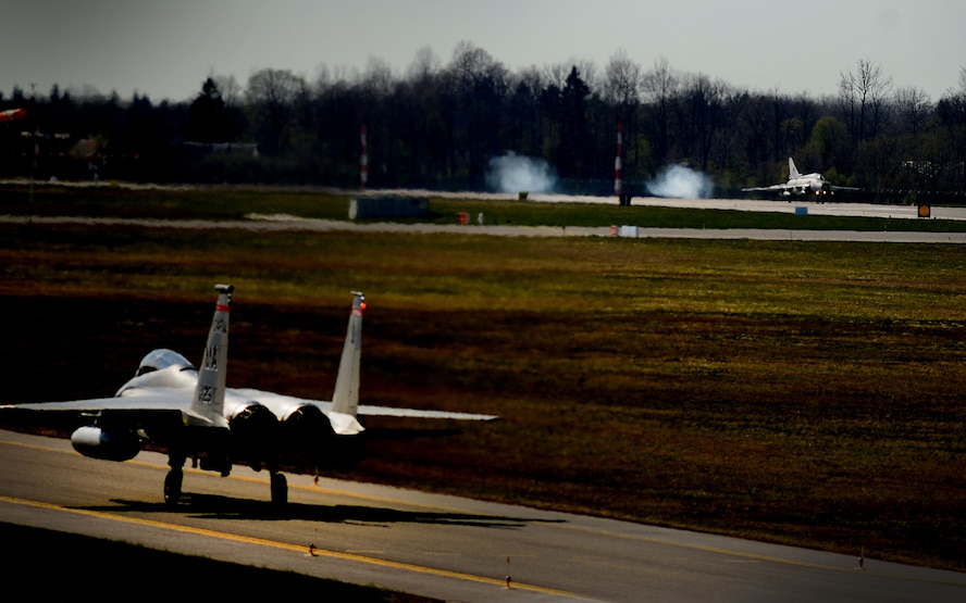 A U.S. F-15C Eagle and a Polish Su-22 Fitter arrive at Amari Air Base, Estonia, in support of exercise Spring Storm May 4, 2016. The 131st Expeditionary Fighter Squadron will fly with the Estonian Defense Force and Polish air force to improve allied air operations and interoperability in a realistic training environment. (U.S. Air Force photo by Tech. Sgt. Matthew Plew/Released)