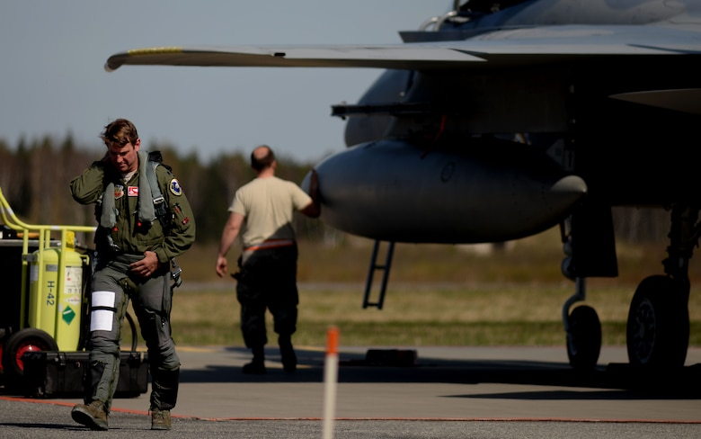 U.S. Air National Guard Lt. Col. Jeff Beckel, 131st Expeditionary Fighter Squadron detachment commander, departs from his F-15C Eagle after landing at Amari Air Base, Estonia, in support of exercise Spring Storm May 4, 2016. As a part of the 131st Expeditionary Fighter Squadron Beckel, flew with the Estonian Defense Force and Polish air force to improve allied air operations and interoperability in a realistic training environment. (U.S. Air Force photo by Tech. Sgt. Matthew Plew/Released)