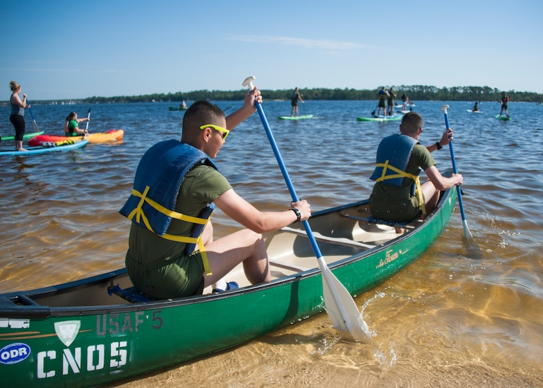 Team Eglin Marines sit in a canoe ready to paddle during the 96th Force Support Squadron's Mission Breakfast May 4 at Eglin Air Force Base, Fla. The 96th FSS's Outdoor Recreation provided free boat and equipment rentals for the day. (U.S. Air Force photo/Ilka Cole)