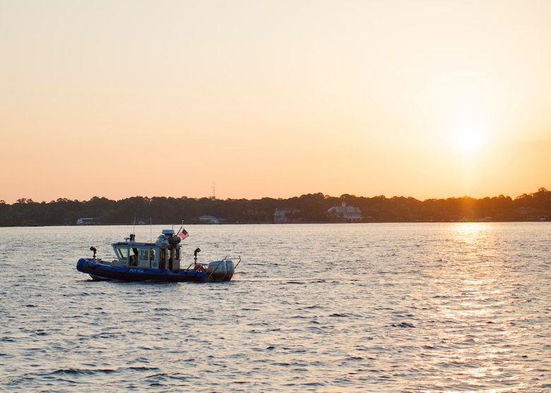 The 96th Security Forces Squadron's boat patrol, Nathan-25 patrols the waters of Post'l Point at sunrise before the 96th Force Support Squadron's Mission Breakfast May 4 at Eglin Air Force Base Fla.  The boat patrol monitors Eglin's 153 mile coastline. (U.S. Air Force photo/Ilka Cole)