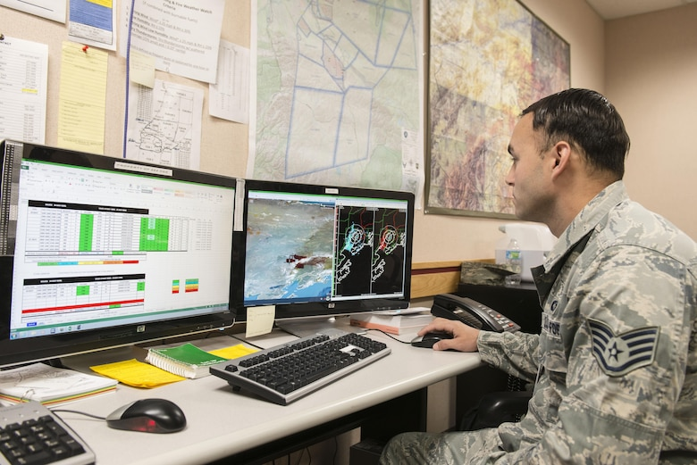 U.S. Air Force Staff Sgt. Joey Putis, an 18th Operations Support Squadron (OSS) weather technician assigned to Kadena Air Base, Japan, checks weather conditions to build a briefing slide, May 4, 2016, at Eielson Air Force Base, Alaska. Putis works with members from the 354th OSS to deliver accurate weather conditions to pilots participating in RED FLAG-Alaska 16-1 from Eielson and Joint Base Elmendorf-Richardson. (U.S. Air Force photo by Staff Sgt. Ashley Nicole Taylor/Released)