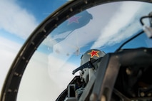 U.S. Air Force Capt. John Peskar, 18th Aggressor Squadron pilot, prepares to refuel an F-16 Fighting Falcon from a KC-135 Stratotanker assigned to the 22nd Air Refueling Wing McConnell Air Force Base, Kansas, May 3, 2016, during RED FLAG-Alaska (RF-A) 16-1 at Eielson Air Force Base, Alaska. RF-A is a Pacific Air Forces command directed field training exercise for U.S. and allied forces, to provide joint offensive counter-air, interdiction, close air support and large force employment training in a simulated combat environment. (U.S. Air Force photo by Staff Sgt. Shawn Nickel/Released)