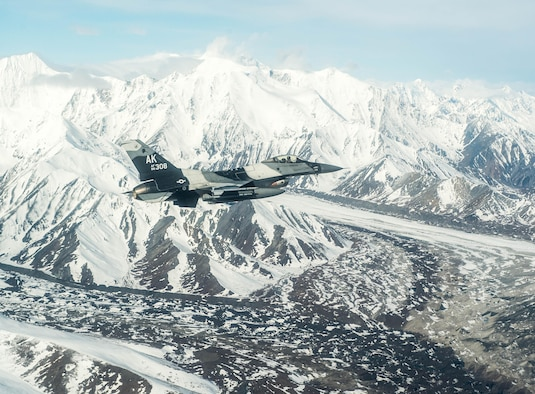 U.S. Air Force Maj. Jeromy Guinther, an 18th Aggressor Squadron pilot, flies an F-16 Fighting Falcon aircraft May 4, 2016, over the Joint Pacific Alaska Range Complex (JPARC), during RED FLAG-Alaska (RF-A) 16-1. Sorties for RF-A are flown in the JPARC, a more than 67,000 square mile area that provides a realistic training environment and allows commanders to train for full spectrum engagements, ranging from individual skills to complex, large-scale joint engagements. (U.S. Air Force photo by Staff Sgt. Shawn Nickel/Released)