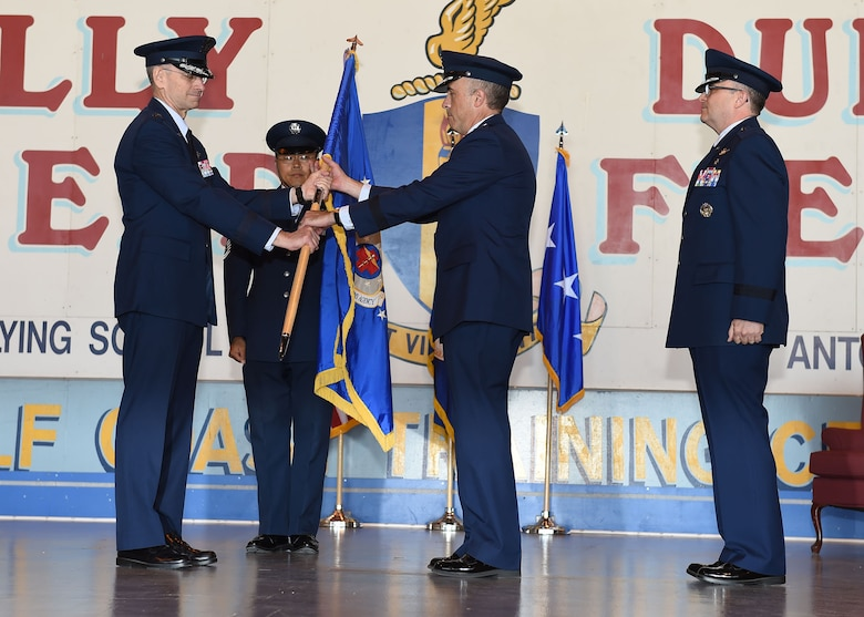Lt. Gen. Mark A. Ediger (left), Surgeon General of the Air Force, passes the Air Force Medical Operations Agency guidon to Brig. Gen. Robert I. Miller (center), incoming AFMOA commander, during a May 6 change of command ceremony at Port San Antonio. In military tradition, the passing of a unit guidon signifies relinquishing or accepting command of that unit. (U.S. Air Force photo / Tech. Sgt. Christopher Carwile.)