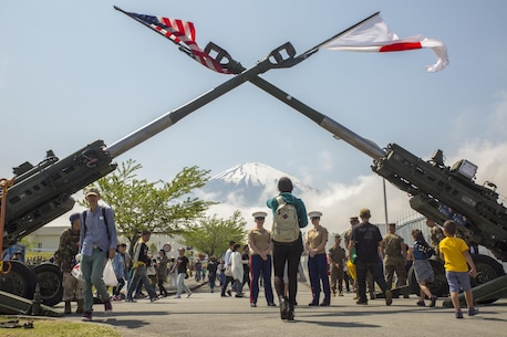 Mount Fuji watches over the Fuji Friendship Festival May 7 aboard Combined Arms Training Center Fuji, Gotemba, Japan. The festival included fun and games for all ages, such as bounce houses, face painting and live music from local artists and the U.S. 7th Fleet Band's Orient Express. The festival also had numerous displays of weapon systems along with aircraft and vehicles. Among them were Japanese tanks, a UH60 Black Hawk and the MV-22B Osprey.