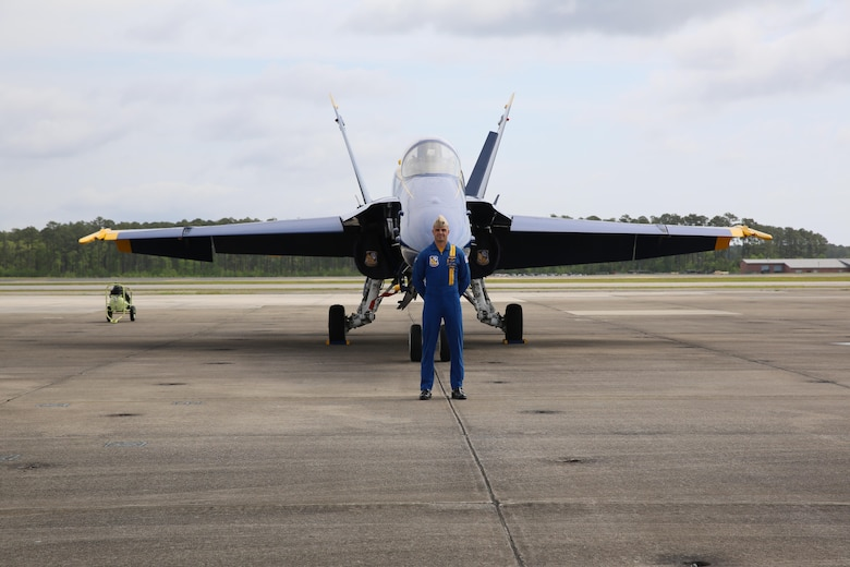"A U.S. Navy Blue Angels polot stands in front of his jet before the 2016 MCAS Cherry Point Air Show – ""Celebrating 75 Years"" at Marine Corps Air Station Cherry Point, N.C., April 28, 2016. The U.S. Navy Blue Angels showcase the pride and professionalism of the Navy and the Marine Corps by inspiring a culture of excellence and service to country through flight demonstrations and community outreach. This year's air show celebrated MCAS Cherry Point and 2nd Marine Aircraft Wing's 75th anniversary and featured 40 static displays, 17 aerial performers, as well as a concert. (U.S. Marine Corps photo by Lance Cpl. Mackenzie Gibson/Released)"