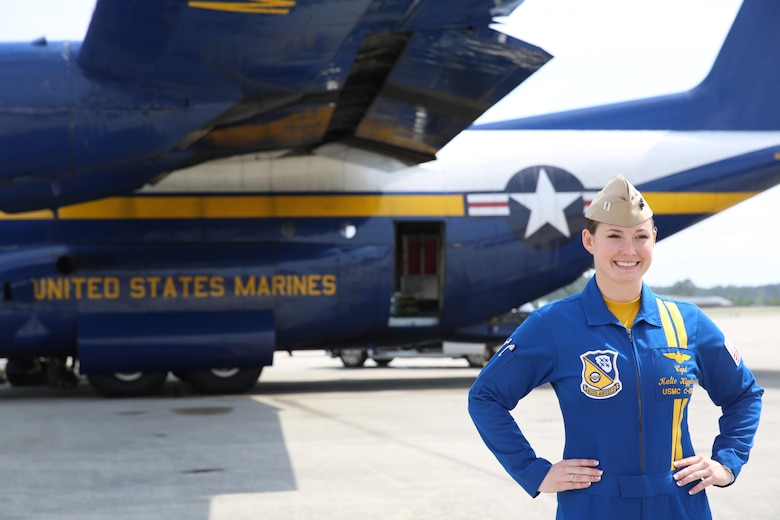 "Capt. Katie Higgins poses in front of ""Fat Albert"", the U.S. Navy Blue Angel's C-130J Super Hercules prior to the 2016 Marine Corps Air Station Cherry Point Air Show -- ""Celebrating 75 Years"" at MCAS Cherry Point, N.C., April 28, 2016.The U.S. Navy Blue Angels showcase the pride and professionalism of the Navy and the Marine Corps by inspiring a culture of excellence and service to country through flight demonstrations and community outreach. This year's air show celebrated MCAS Cherry Point and 2nd Marine Aircraft Wing's 75th anniversary and featured 40 static displays, 17 aerial performers, as well as a concert. Higgins is the pilot for Fat Albert. (U.S. Marine Corps photo by Lance Cpl. Mackenzie Gibson/Released)"