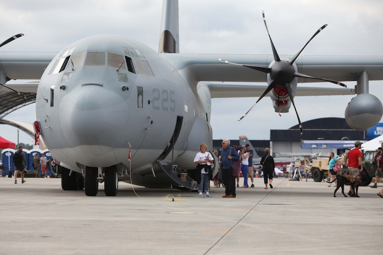 "Marines, Sailors and civilian air show patrons tour the inside and outside of a C-130J Super Hercules during the 2016 MCAS Cherry Point Air Show --  ""Celebrating 75 Years"" at Marine Corps Air Station Cherry Point, N.C., April 29, 30 and May 1, 2016. This years air show celebrated the 75th anniversary of 2nd Marine Aircraft Wing and MCAS Cherry Point and featured 40 static displays and 17 aerial performers."