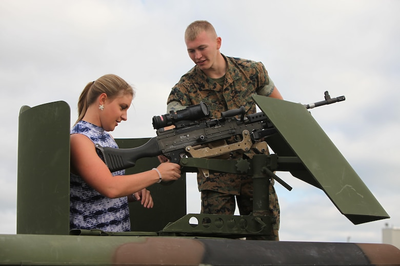 "A Marine describes the functions of a weapon to an air show patron during the 2016 MCAS Cherry Point Air Show --  ""Celebrating 75 Years"" at Marine Corps Air Station Cherry Point, N.C., April 29, 30 and May 1, 2016. This years air show celebrated the 75th anniversary of 2nd Marine Aircraft Wing and MCAS Cherry Point and featured 40 static displays and 17 aerial performers."