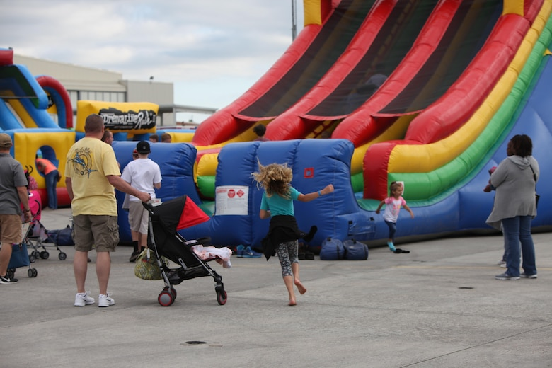 "Children play on bouncy houses and rock walls in the kid zone at the 2016 MCAS Cherry Point Air Show – ""Celebrating 75 Years"" at Marine Corps Air Station Cherry Point, N.C., April 29, 2016. This year's air show celebrated MCAS Cherry Point and 2nd Marine Aircraft Wing's 75th anniversaries and featured 40 static displays, 17 aerial performers and a concert."