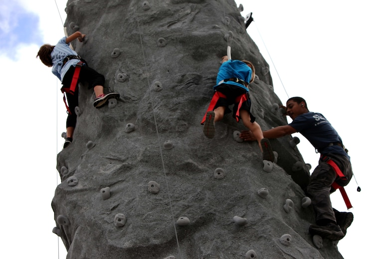 "Children climb on rock walls in the kid zone at the 2016 MCAS Cherry Point Air Show – ""Celebrating 75 Years"" at Marine Corps Air Station Cherry Point, N.C., April 29, 2016. This year's air show celebrated MCAS Cherry Point and 2nd Marine Aircraft Wing's 75th anniversaries and featured 40 static displays, 17 aerial performers and a concert."