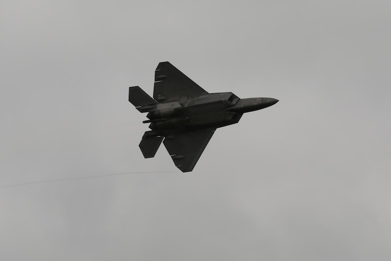 "A U.S. Air Force F-22 Raptor rumbles the ground and amazes airshow patrons at the 2016 Marine Corps Air Station Cherry Point Air Show – ""Celebrating 75 Years"" at MCAS Cherry Point, N.C., April 29, 2016. The Air Force's F-22 Raptor combines sensor capabilities with integrated avionics, situational awareness and weapons to provide the first-kill opportunity against threats by performing air-to-air and air-to-ground missions. This year's air show celebrated MCAS Cherry Point and 2nd Marine Aircraft Wing's 75th anniversary and featured 40 static displays, 17 aerial performers, as well as a concert. (U.S. Marine Corps photo by Lance Cpl. Mackenzie Gibson/Released)"