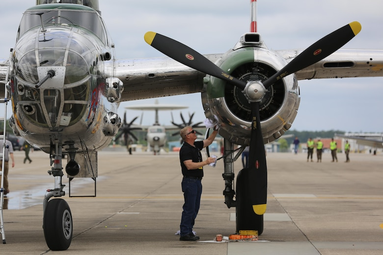 "Paul Nuwer, the pilot for the B-52 Bomber ""Panchito"", cleans his plane on the flight line at the 2016 Marine Corps Air Station Cherry Point Air Show -- ""Celebrating 75 Years"" at MCAS Cherry Point, N.C., April 29, 2016. The North American B25 was among the famous twin engine medium bombers used during World War II. (U.S. Marine Corps photo by Lance Cpl. Mackenzie Gibson/ Released)"