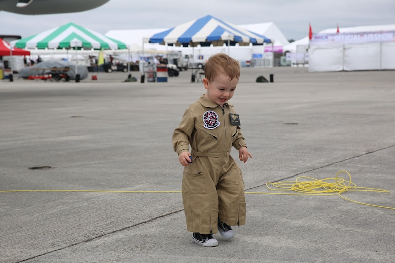 "A child plays among the many static displays at the 2016 Marine Corps Air Station Cherry Point Air Show – ""Celebrating 75 Years"" at MCAS Cherry Point, N.C., April 29, 2016. This year's air show celebrated MCAS Cherry Point and 2nd Marine Aircraft Wing's 75th anniversaries and featured 40 static displays, 17 aerial performers and a concert. (U.S. Marine Corps photo by Lance Cpl. Mackenzie Gibson/ Released)"