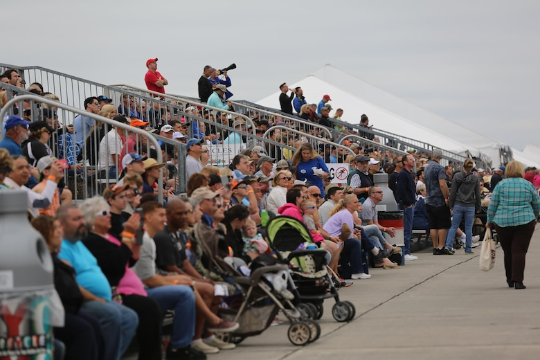 "Spectators watch in awe as performars soar through the sky at the 2016 Marine Corps Air Station Cherry Point Air Show – ""Celebrating 75 Years"" at MCAS Cherry Point, N.C., April 30, 2016. This year's air show celebrated MCAS Cherry Point and 2nd Marine Aircraft Wing's 75th anniversary and featured 40 static displays, 17 aerial performers, as well as a concert. (U.S. Marine Corps photo by Lance Cpl. Mackenzie Gibson/Released)"