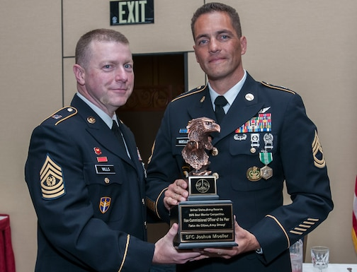 Sgt. 1st Class Joshua Moeller, a drill sergeant with the 108th Training Command (IET) and the 2016 U.S. Army Reserve Noncommissioned Officer of the Year, stands with the USAR Interim Command Sgt. Maj. James P. Wills at the awards banquet May 6. The 2016 USAR BWC held May 2-4 at Fort Bragg, N.C., determined the top noncommissioned officer and junior enlisted Soldier to represent the U.S. Army Reserve in the Department of the Army Best Warrior Competition later this year at Fort A.P. Hill, Va. (U.S. Army photo by Sgt. Darryl Montgomery) (Released)
