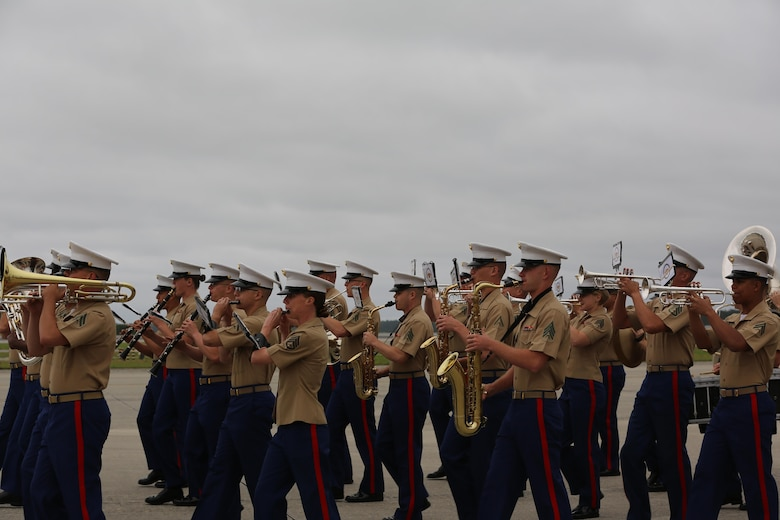 "The Second Marine Aircraft Wing Band performs for spactators at the 2016 Marine Corps Air Station Cherry Point Air Show – ""Celebrating 75 Years"" at MCAS Cherry Point, N.C., April 30, 2016. The Second Marine Aircraft Wing Band continues this fine tradition by representing one of the finest organizations in musical excellence. This ensemble of Marine musicians completes over 150 commitments annually and travels in excess of 30,000 miles. Throughout their travels, they uphold the old and honored Marine traditions of pride, professionalism, and esprit de corps. (U.S. Marine Corps photo by Lance Cpl. Mackenzie Gibson/ Released)"