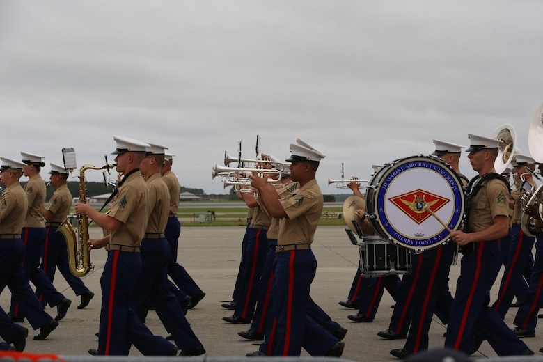 "The Second Marine Aircraft Wing Band performs for spactators at the2016 Marine Corps Air Station Cherry Point Air Show – ""Celebrating 75 Years"" at MCAS Cherry Point, N.C., April 30, 2016. The Second Marine Aircraft Wing Band continues this fine tradition by representing one of the finest organizations in musical excellence. This ensemble of Marine musicians completes over 150 commitments annually and travels in excess of 30,000 miles. Throughout their travels, they uphold the old and honored Marine traditions of pride, professionalism, and esprit de corps. (U.S. Marine Corps photo by Lance Cpl. Mackenzie Gibson/ Released)"