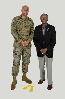 Sgt. Frederick Graham (left), heavy equipment engineer maintenance chief, Organic Maintenance Unit, Marine Corps Logistics Command, meets one of the original Montford Point Marines, Henry L. Jackson, a World War II veteran and retired U.S. Air Force master sergeant. Jackson, a Congressional Gold Medal recipient, was one of the 20,000 African-American Marines to attend basic training at Montford Point, North Carolina, on a mandate from then-President Franklin D. Roosevelt, during the period between 1942 and 1949. Jackson and Graham, who recently met, shared some of their experiences in the Marine Corps.