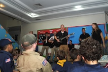 Tech Sgt. Clinton Whitney, Air Force Central Command Galaxy band vocalist and acoustic guitar player, performs with his fellow bandsmen for a local Boy Scout troop May 2, 2016 in Southwest Asia.  After the performance, the scouts were able to ask the musicians several questions on what it's like to be a member of the AFCENT Band. (U.S. Air Force photo by Senior Airman Zachary Kee)