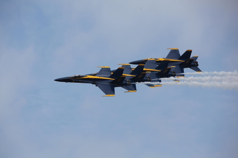 "The U.S. Navy Blue Angels fly through the sky over the 2016 Marine Corps Air Station Cherry Point Air Show -- ""Celebrating 75 Years"" at MCAS Cherry Point, N.C., April 30, 2016. Blue Angels showcase the pride and professionalism of the Navy and the Marine Corps by inspiring a culture of excellence and service to country through flight demonstrations and community outreach. This year's air show celebrated MCAS Cherry Point and 2nd Marine Aircraft Wing's 75th anniversary and featured 40 static displays, 17 aerial performers, as well as a concert."