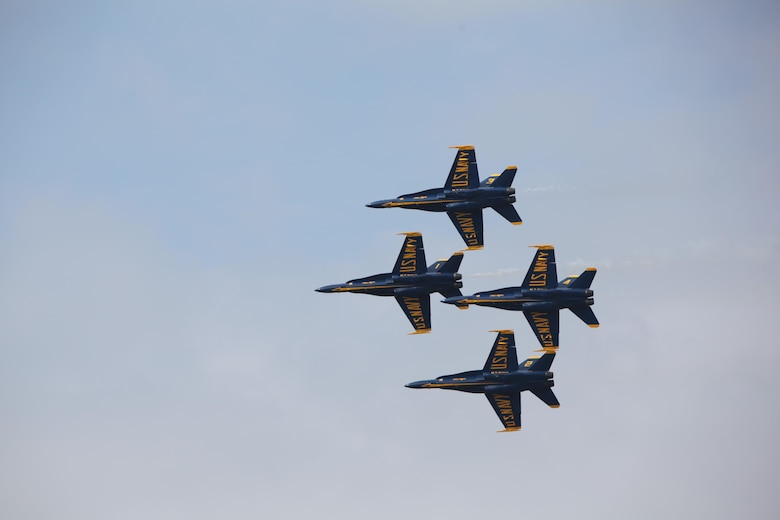 "The U.S. Navy Blue Angels fly through the sky over the flight line at the 2016 Marine Corps Air Station Cherry Point Air Show -- ""Celebrating 75 Years"" at MCAS Cherry Point, N.C., April 30, 2016. Blue Angels showcase the pride and professionalism of the Navy and the Marine Corps by inspiring a culture of excellence and service to country through flight demonstrations and community outreach. This year's air show celebrated MCAS Cherry Point and 2nd Marine Aircraft Wing's 75th anniversary and featured 40 static displays, 17 aerial performers, as well as a concert."