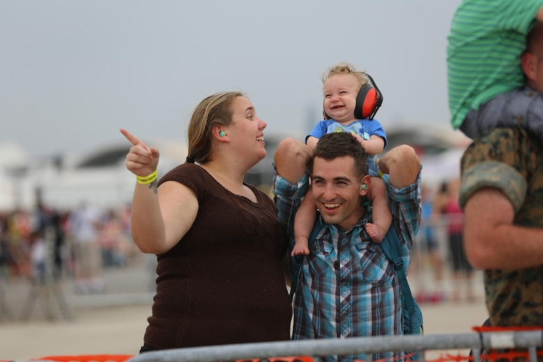"A family enjoys watching the U.S. Navy Blue Angels perform at the 2016 Marine Corps Air Station Cherry Point Air Show – ""Celebrating 75 Years"" at MCAS Cherry Point, N.C., May 1, 2016. This year's air show celebrated MCAS Cherry Point and 2nd Marine Aircraft Wing's 75th anniversaries and featured 40 static displays, 17 aerial performers and a concert. (U.S. Marine Corps photo by Lance Cpl. Mackenzie Gibson/ Released)"